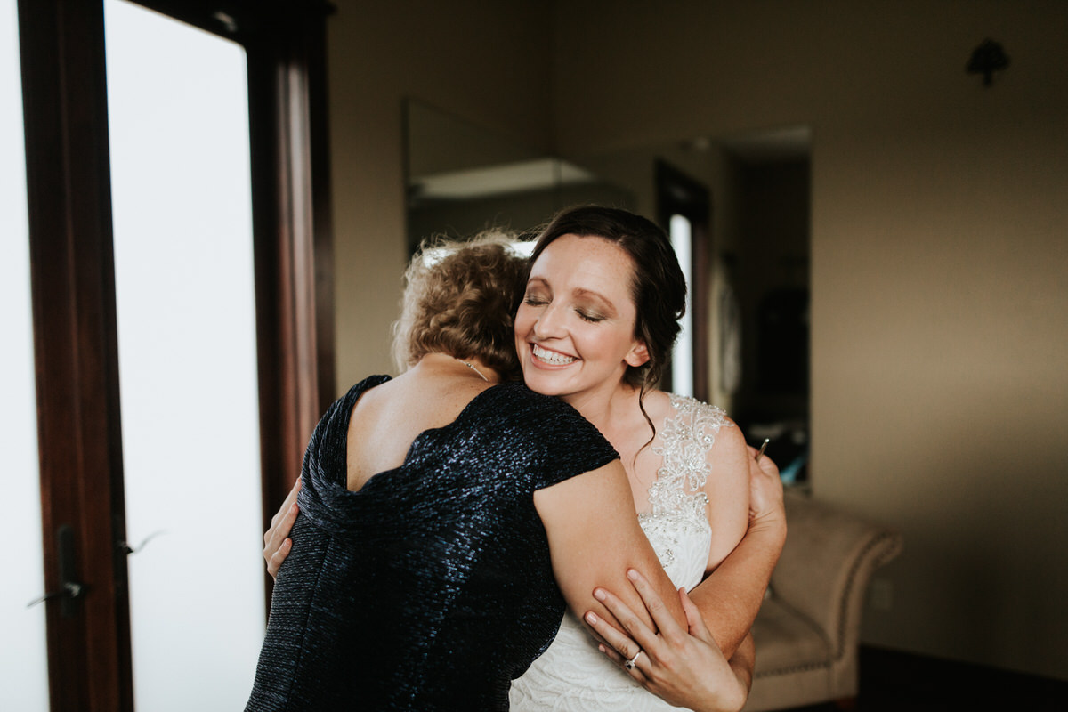 Bride hugging her mother at Ranch Austin wedding