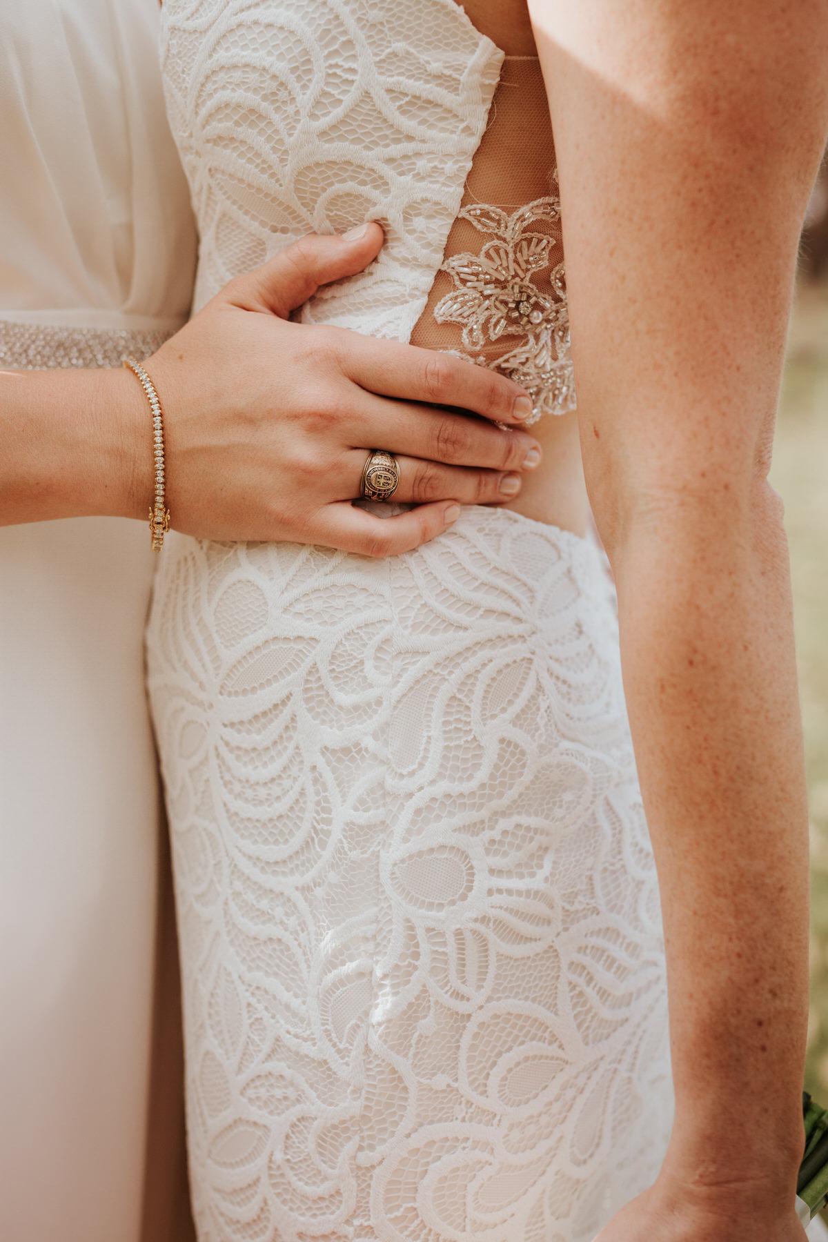 Close-up of two brides hugging at Ranch Austin wedding