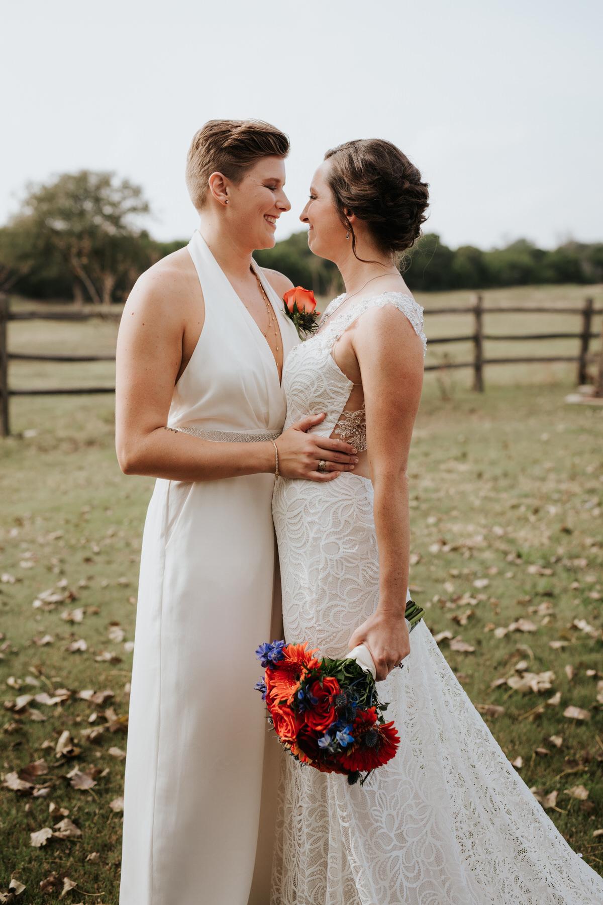 Two happy brides posing at Ranch Austin wedding