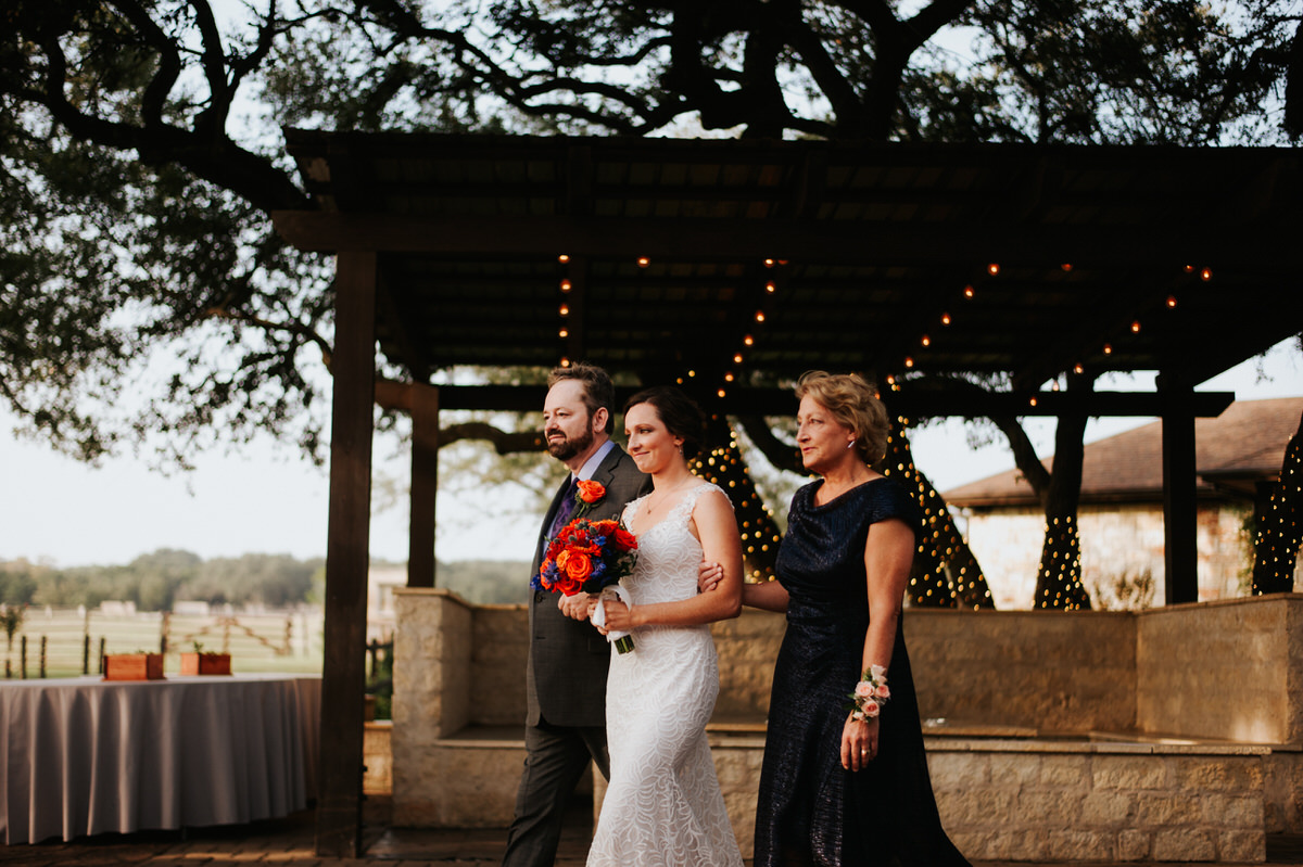 Bride walking down the aisle with her parents at Ranch Austin wedding