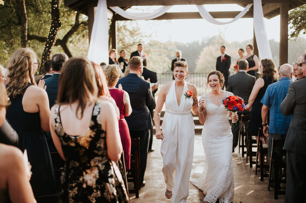 Brides walking down the aisle at Ranch Austin wedding