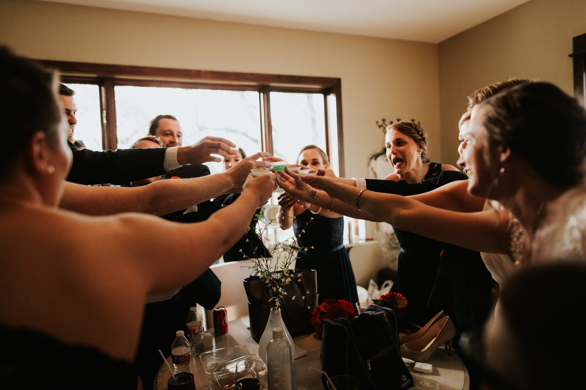 Brides taking jello shots with wedding party at Ranch Austin wedding