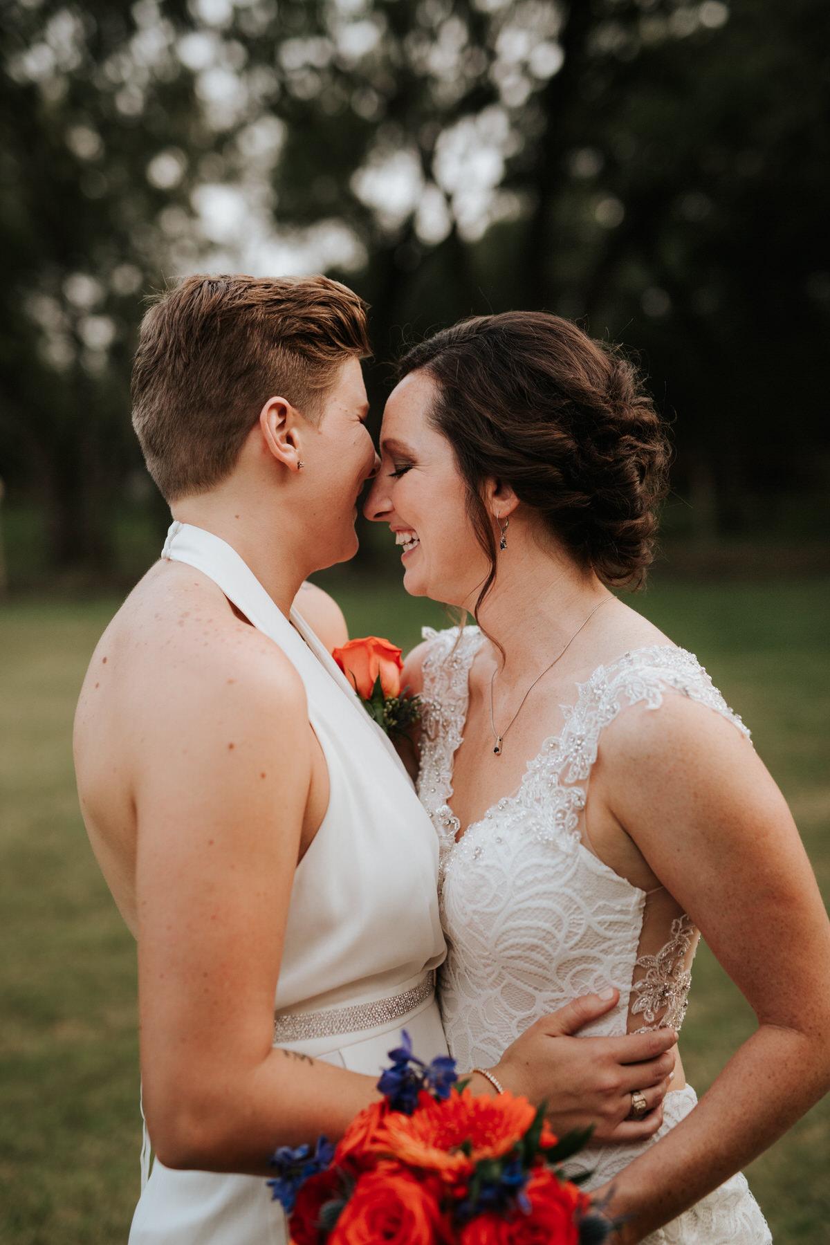 Brides laughing and kissing at Ranch Austin wedding