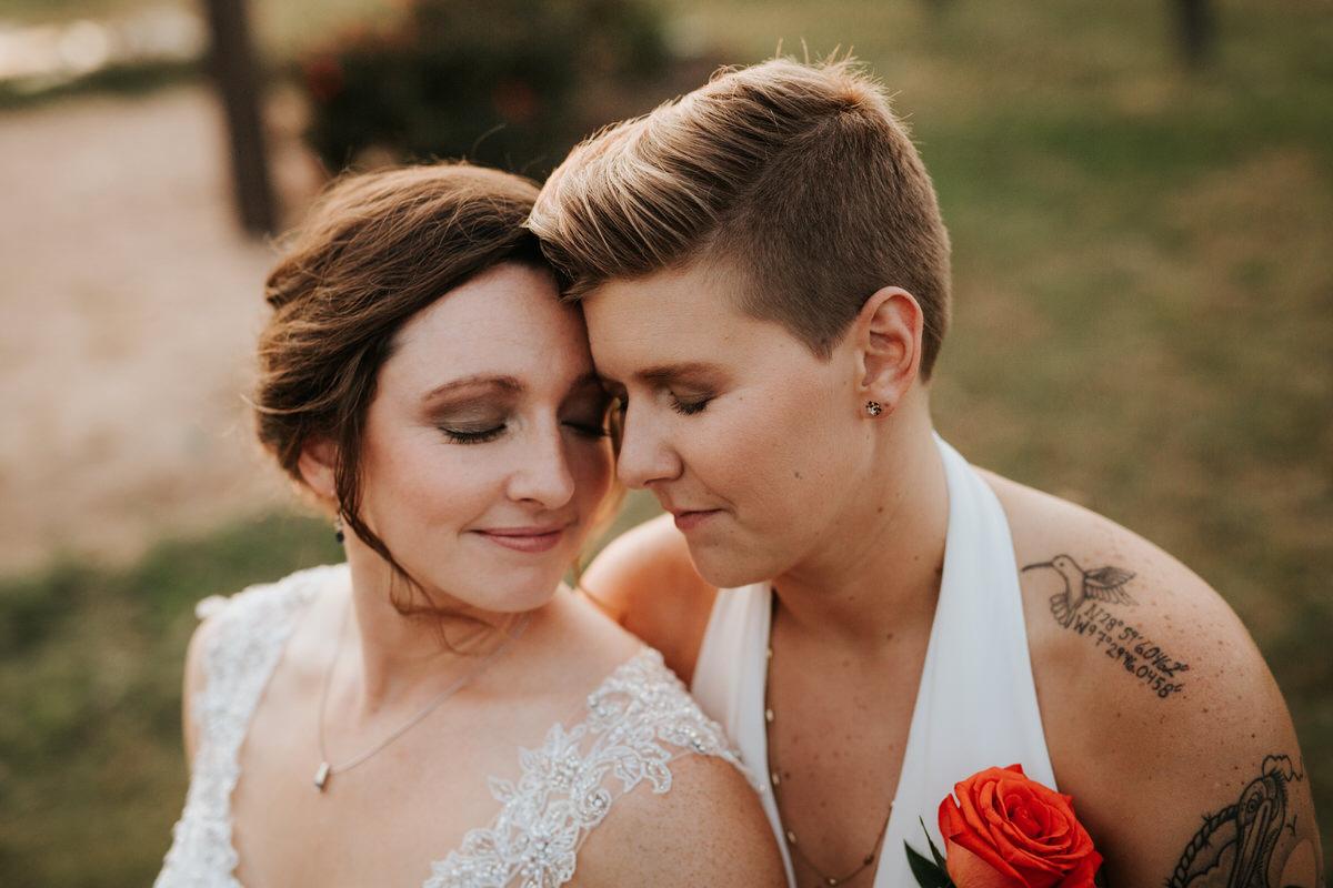 Texas brides smiling at Ranch Austin wedding