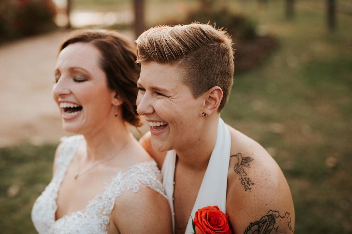Texas brides laughing at Ranch Austin wedding