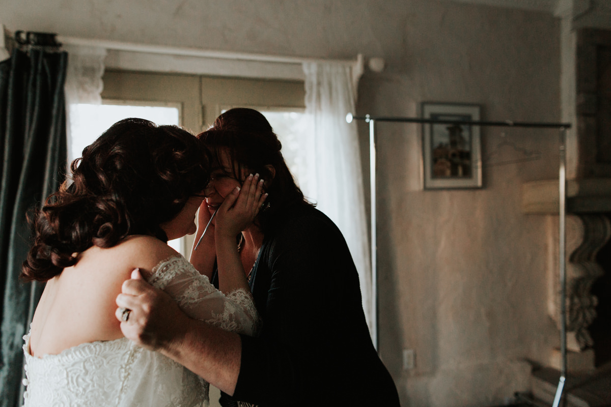 Bride getting ready for wedding with mother