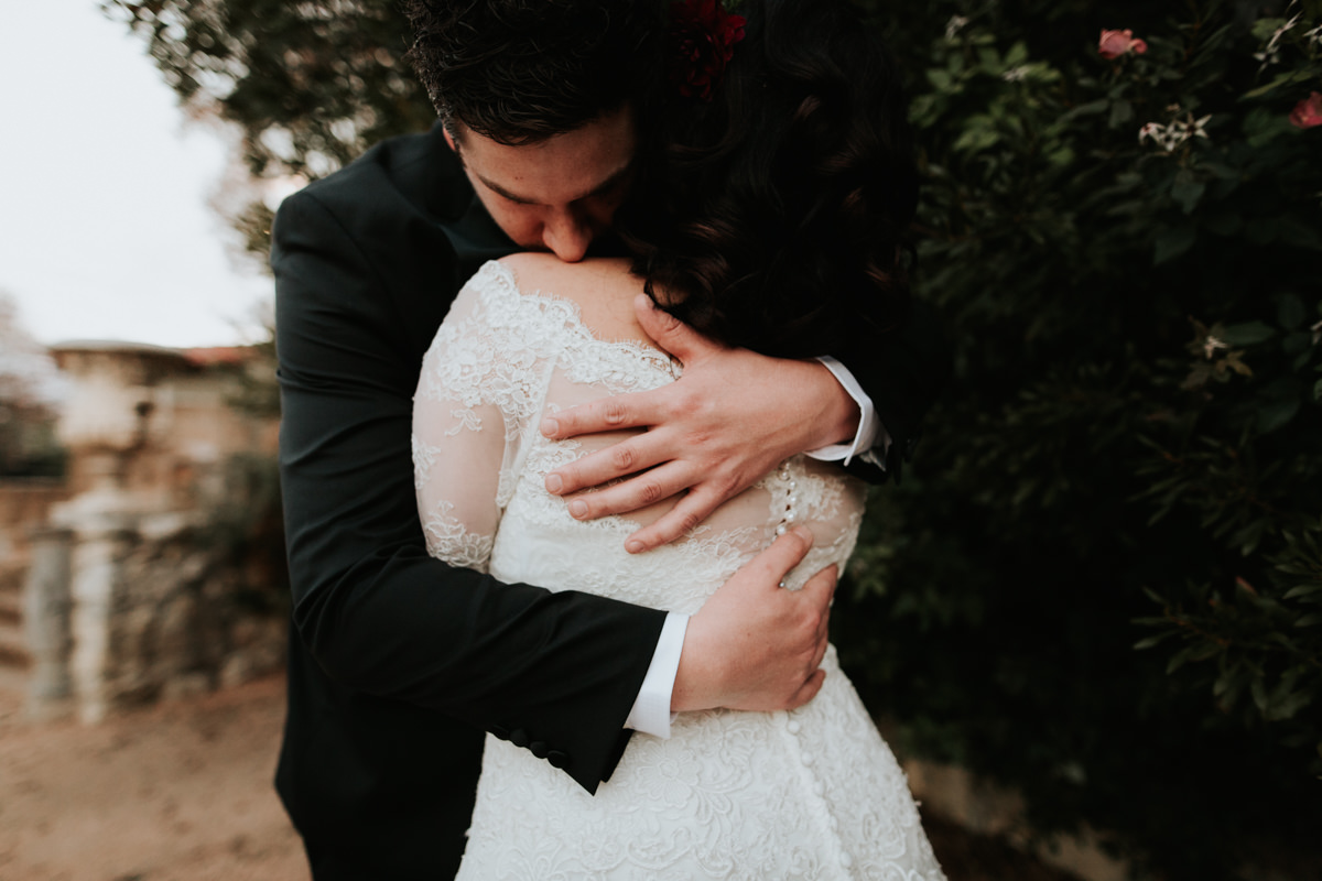 Bride and groom holding each other before Christmas wedding