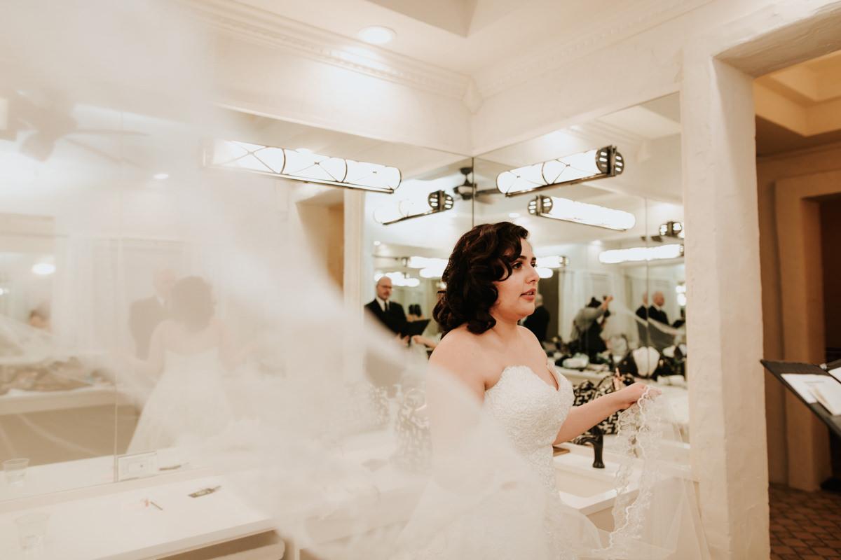 Bride twirling dress before wedding