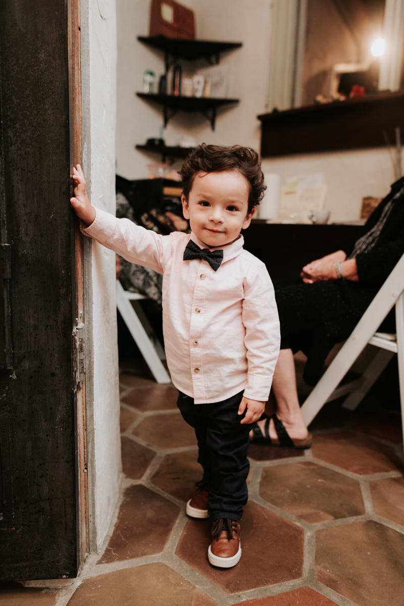 Tiny wedding guest in a bowtie