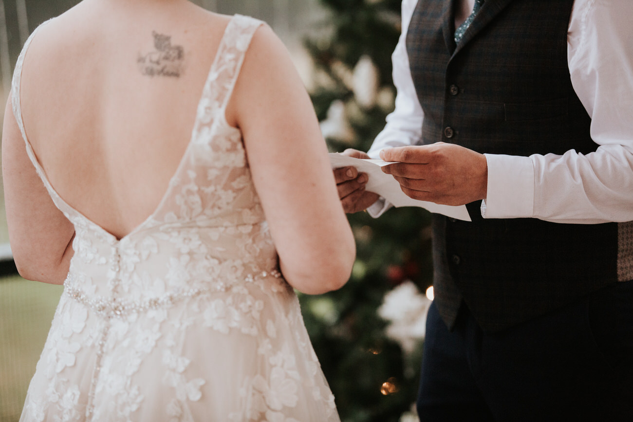 Bride and groom saying vows at Christmas wedding