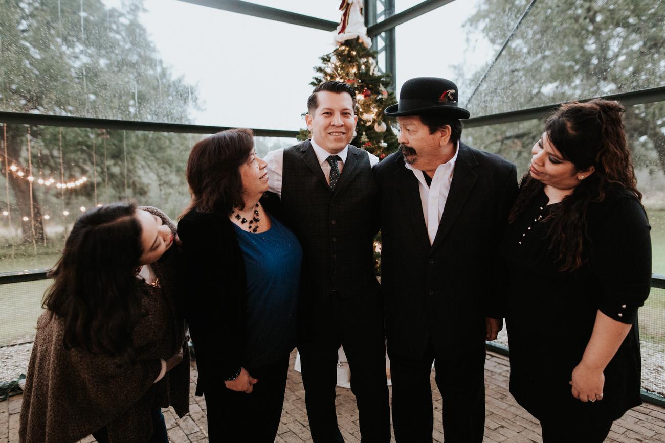 Groom with family at Christmas wedding