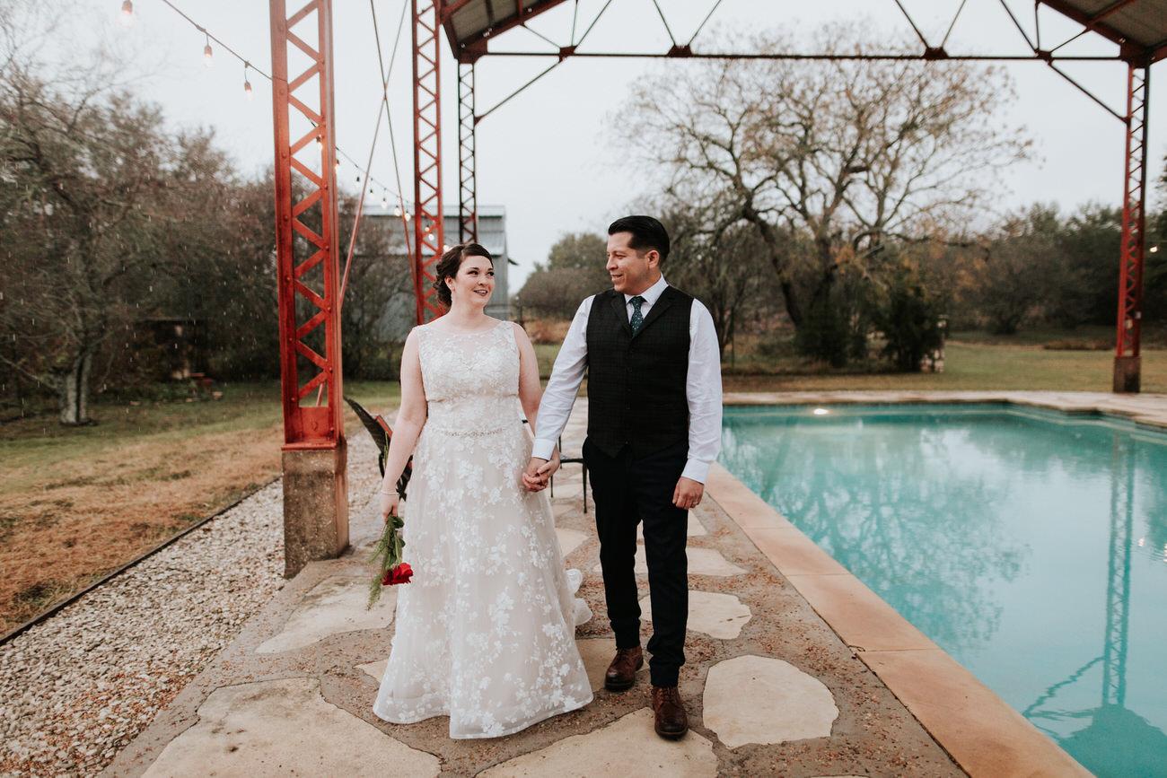 Bride and groom outside at Christmas wedding
