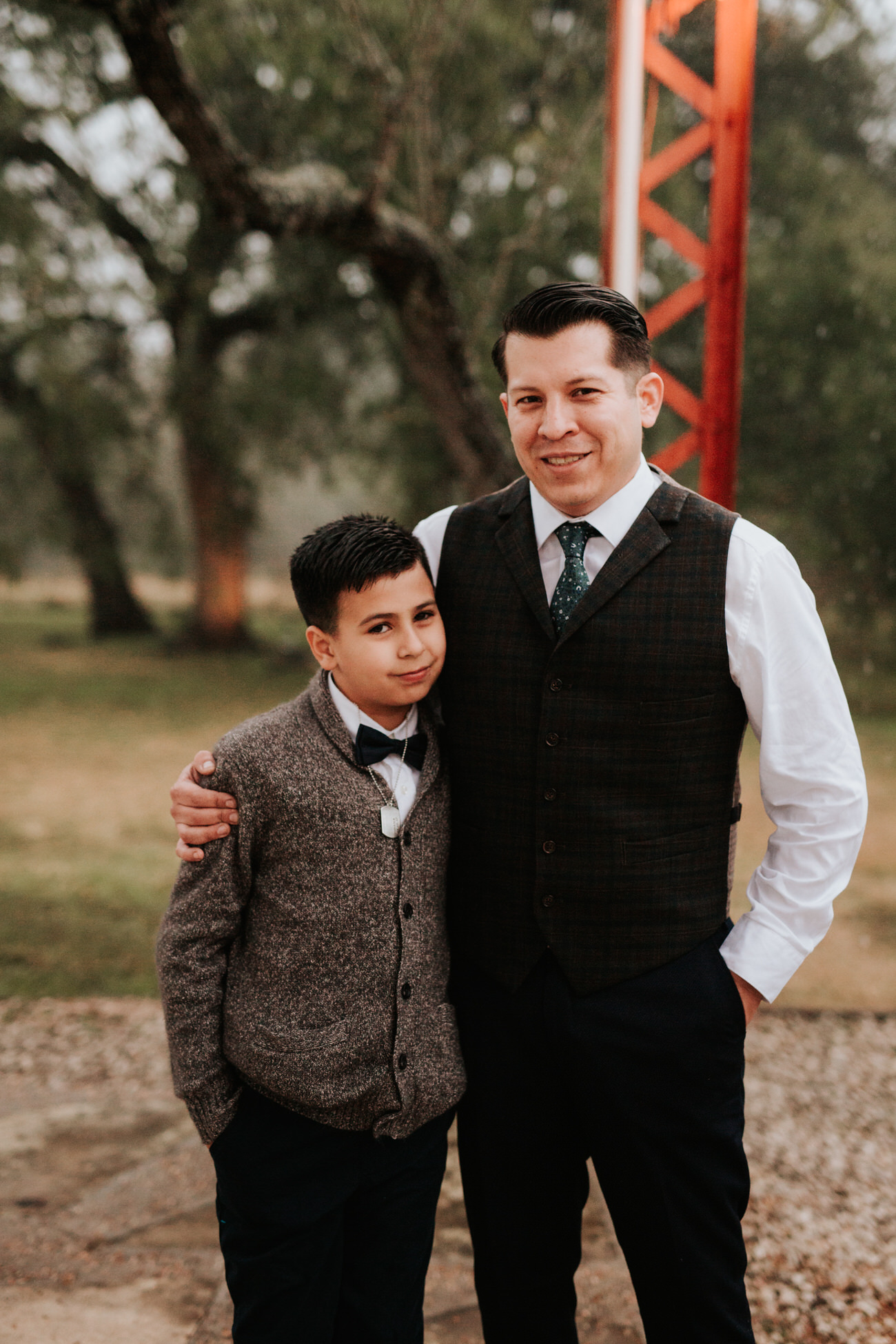 Groom with a child at Christmas wedding