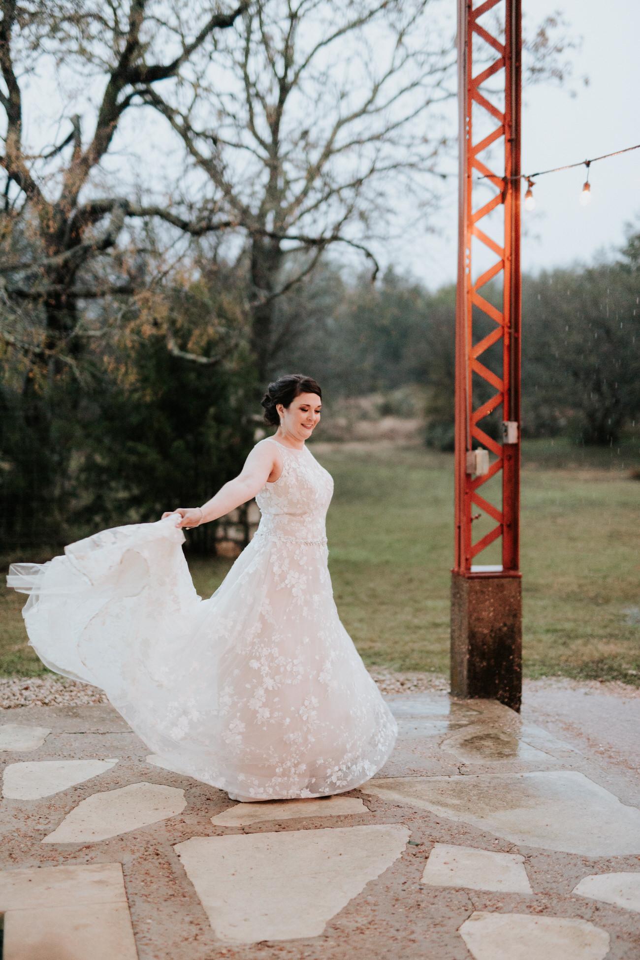Bride twirling dress outside