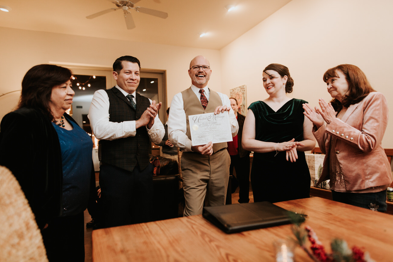 Officiant signing wedding certificate