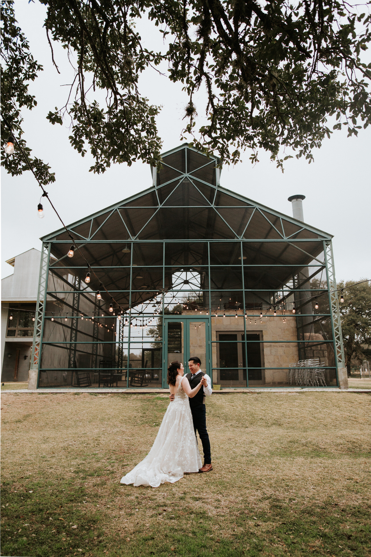 Bride and groom in front of venue