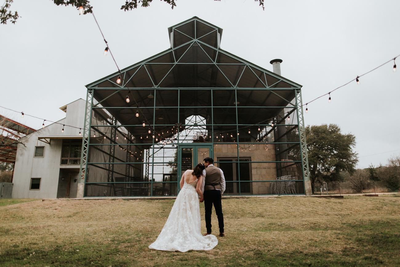 Bride and groom in front of wedding venue