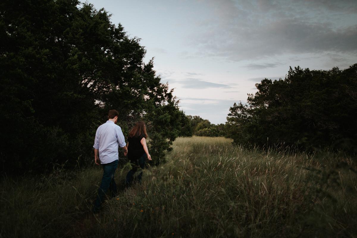 Engaged couple walking away