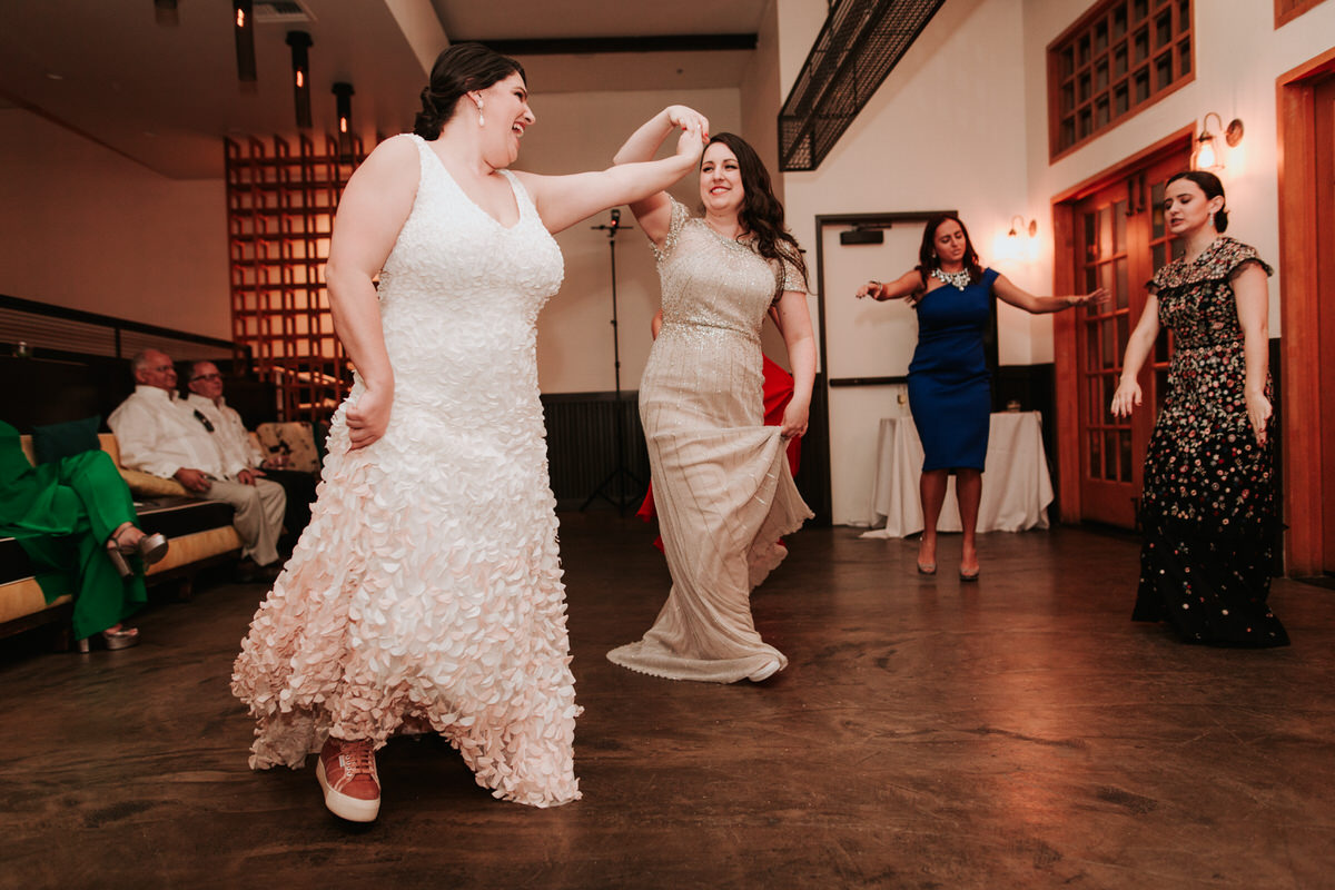 Brides dancing at Saguaro wedding