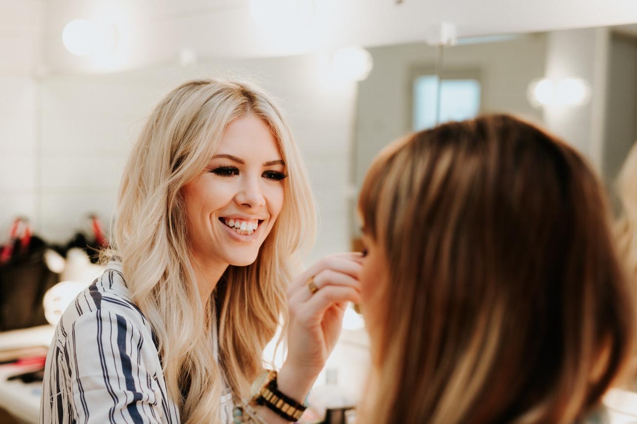 Makeup artist applying makeup on woman
