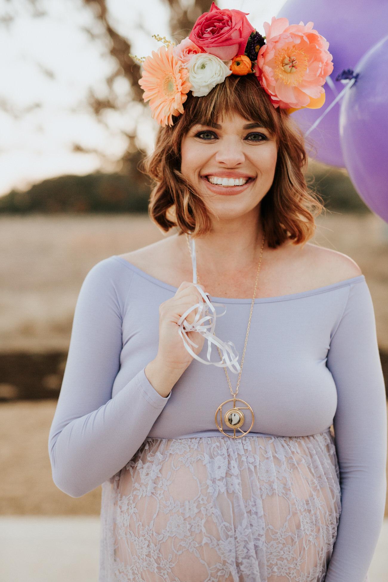 Beautiful pregnant woman at ultraviolet maternity shoot