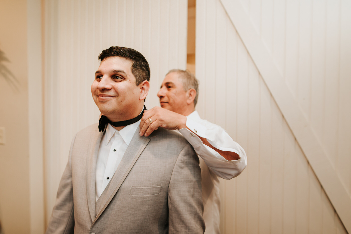 Groom getting ready for wedding at Pecan Springs Ranch
