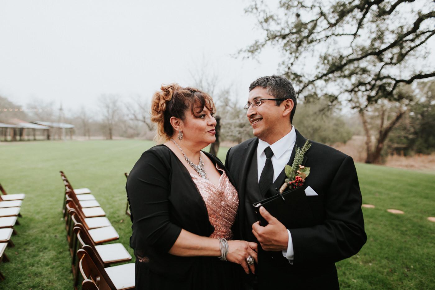 Wedding guests talking at Pecan Springs Ranch