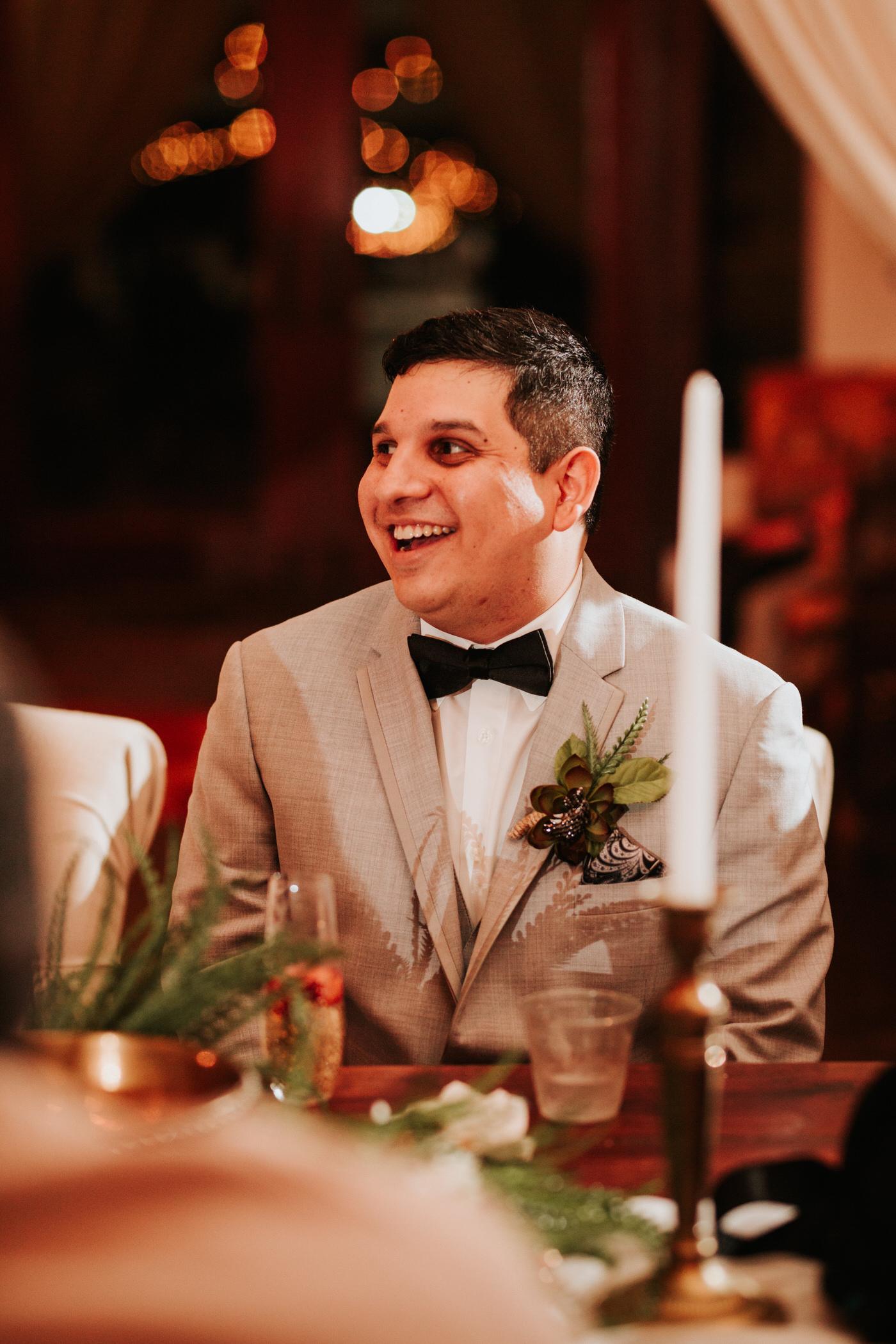 Groom at Pecan Springs Ranch wedding reception