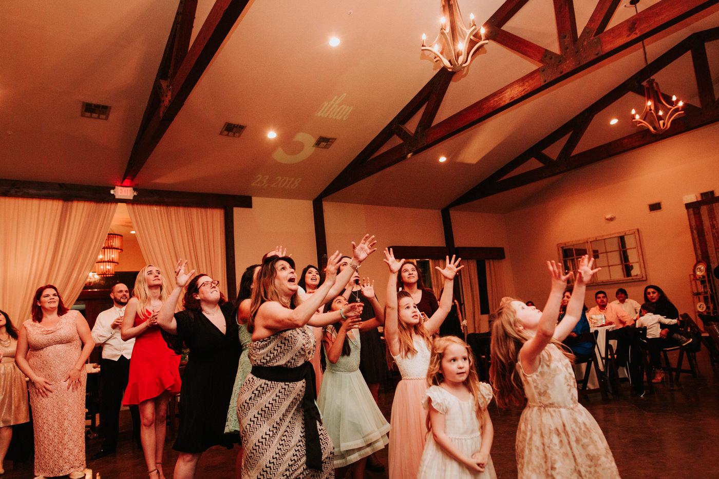 Bouquet toss at Austin wedding