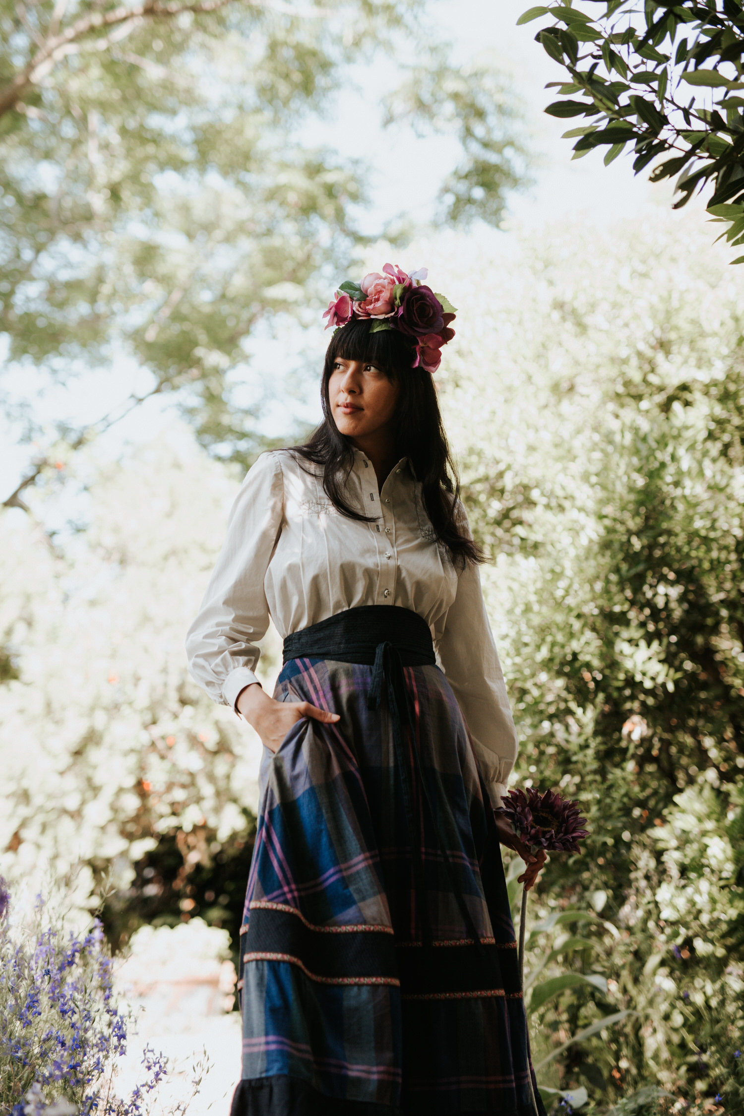 Woman in flower crown and Rat Des Champs vintage outfit
