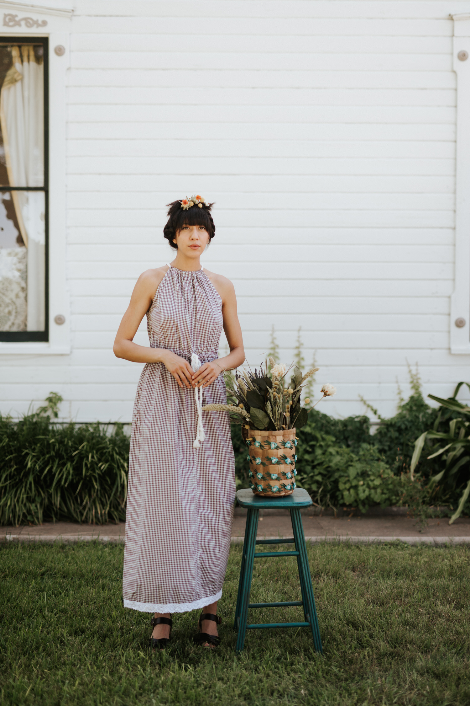 Woman in Rat Des Champs vintage dress with plant in basket