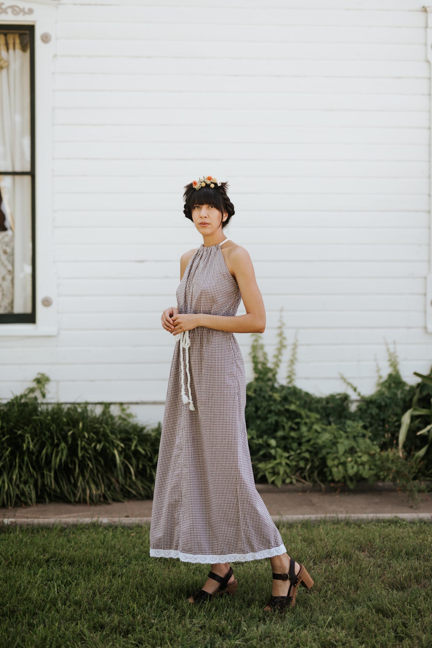 Woman in Rat Des Champs vintage dress and flower crown