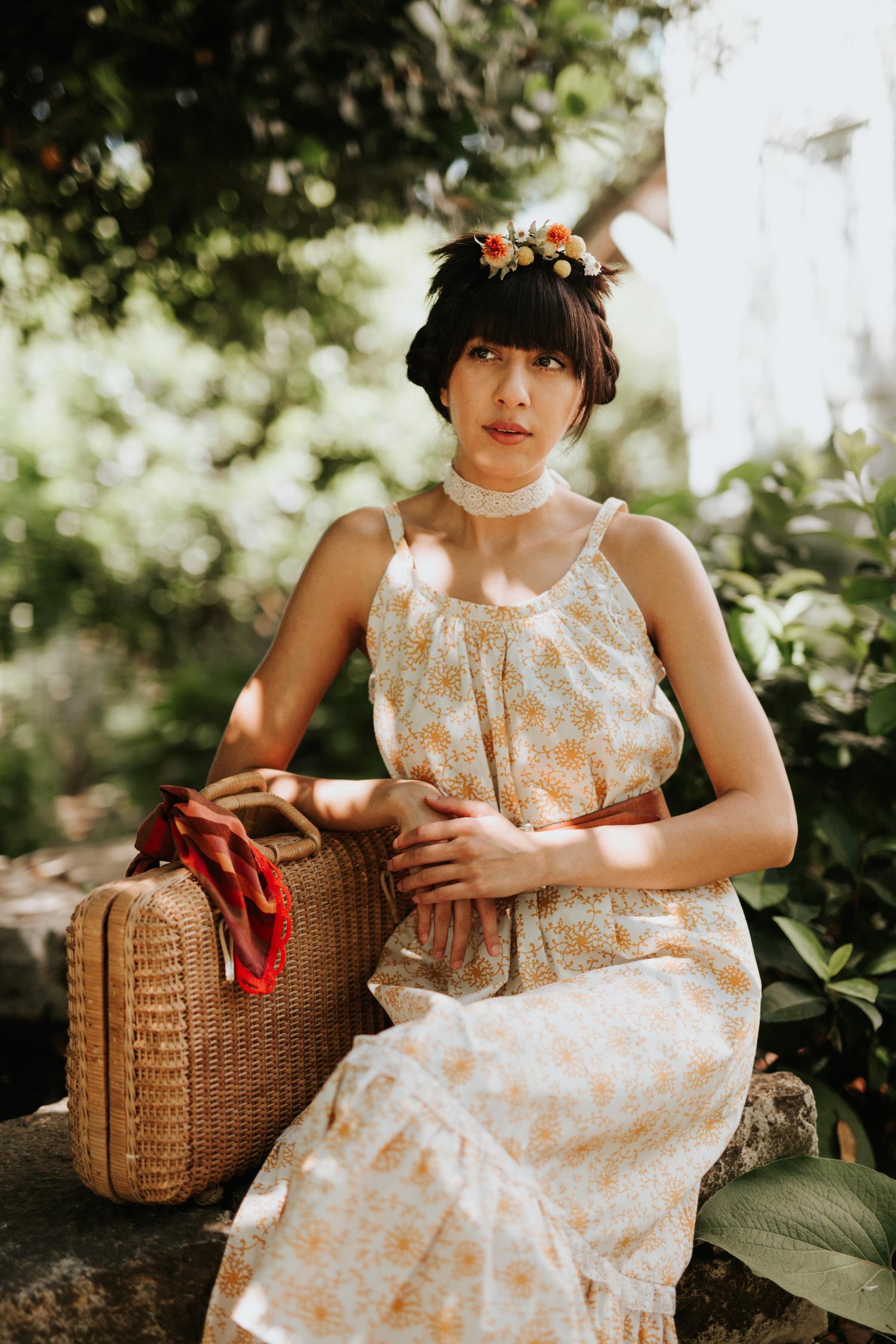 Woman in Rat Des Champs vintage dress with vintage basket case