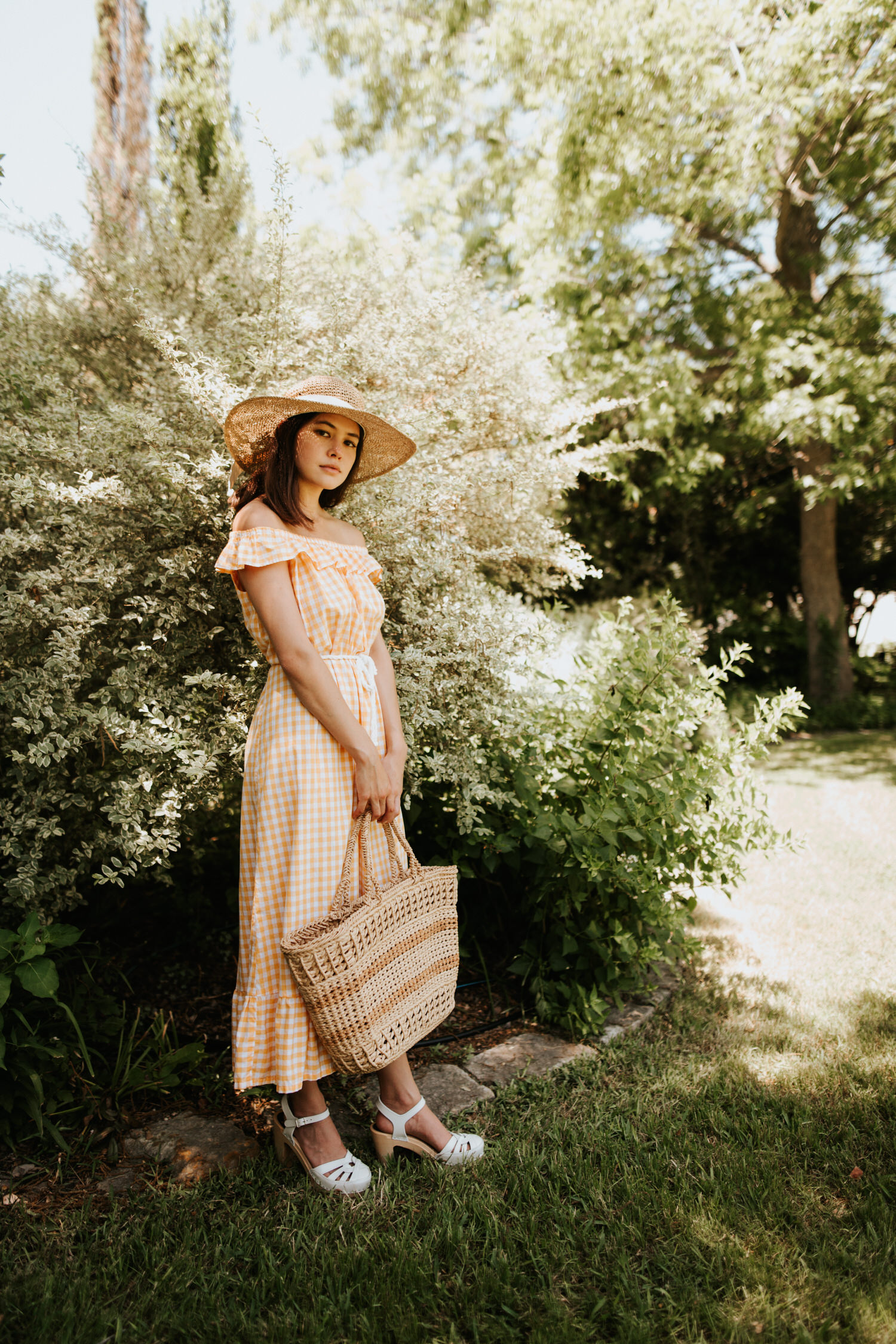 Woman in yellow gingham vintage dress