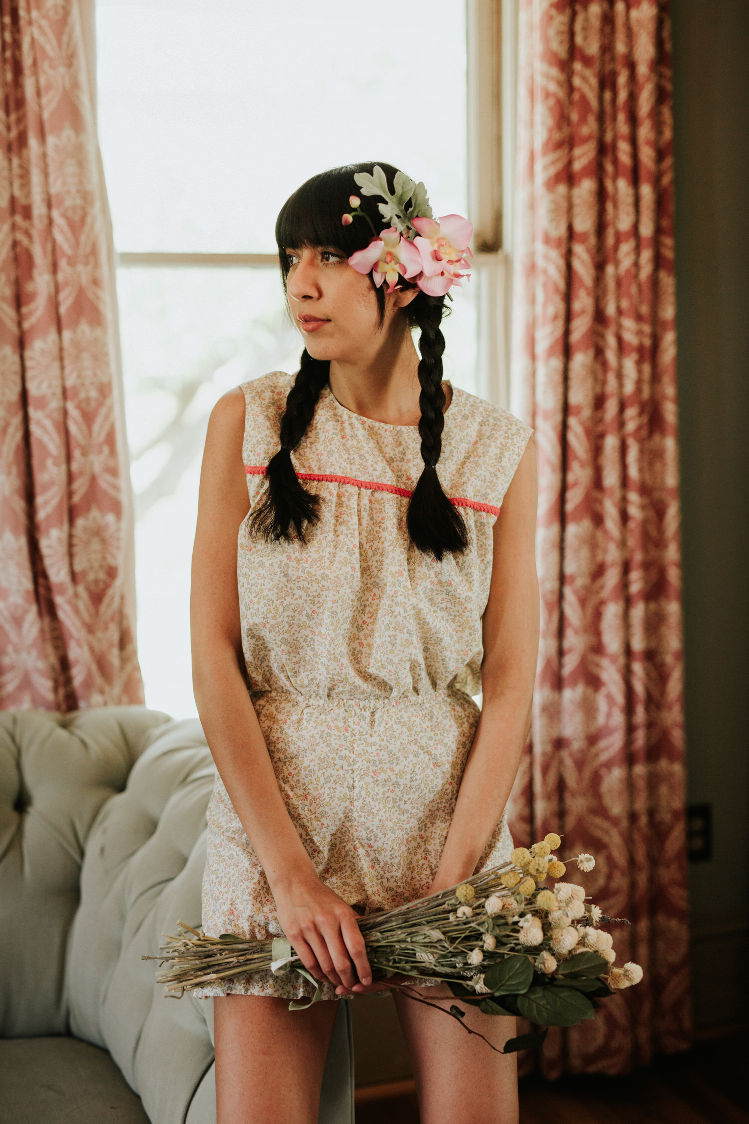 Woman in vintage romper with flower bouquet