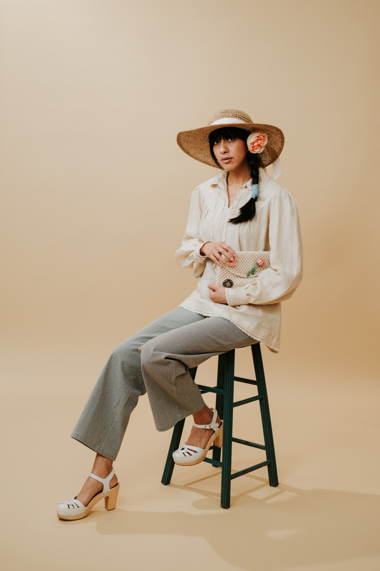 Woman in vintage pants and shirt