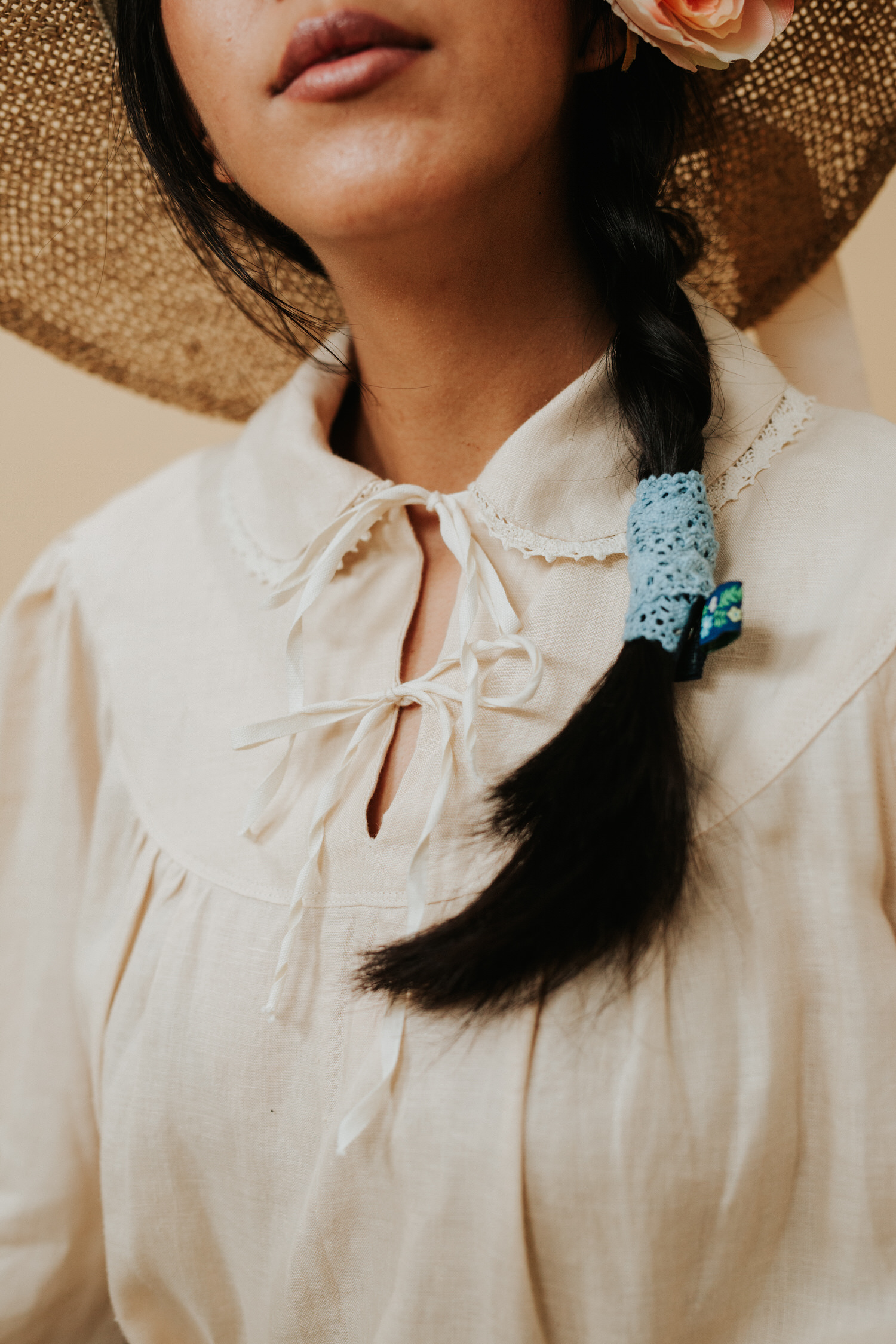 Woman with a braid in a vintage sun hat