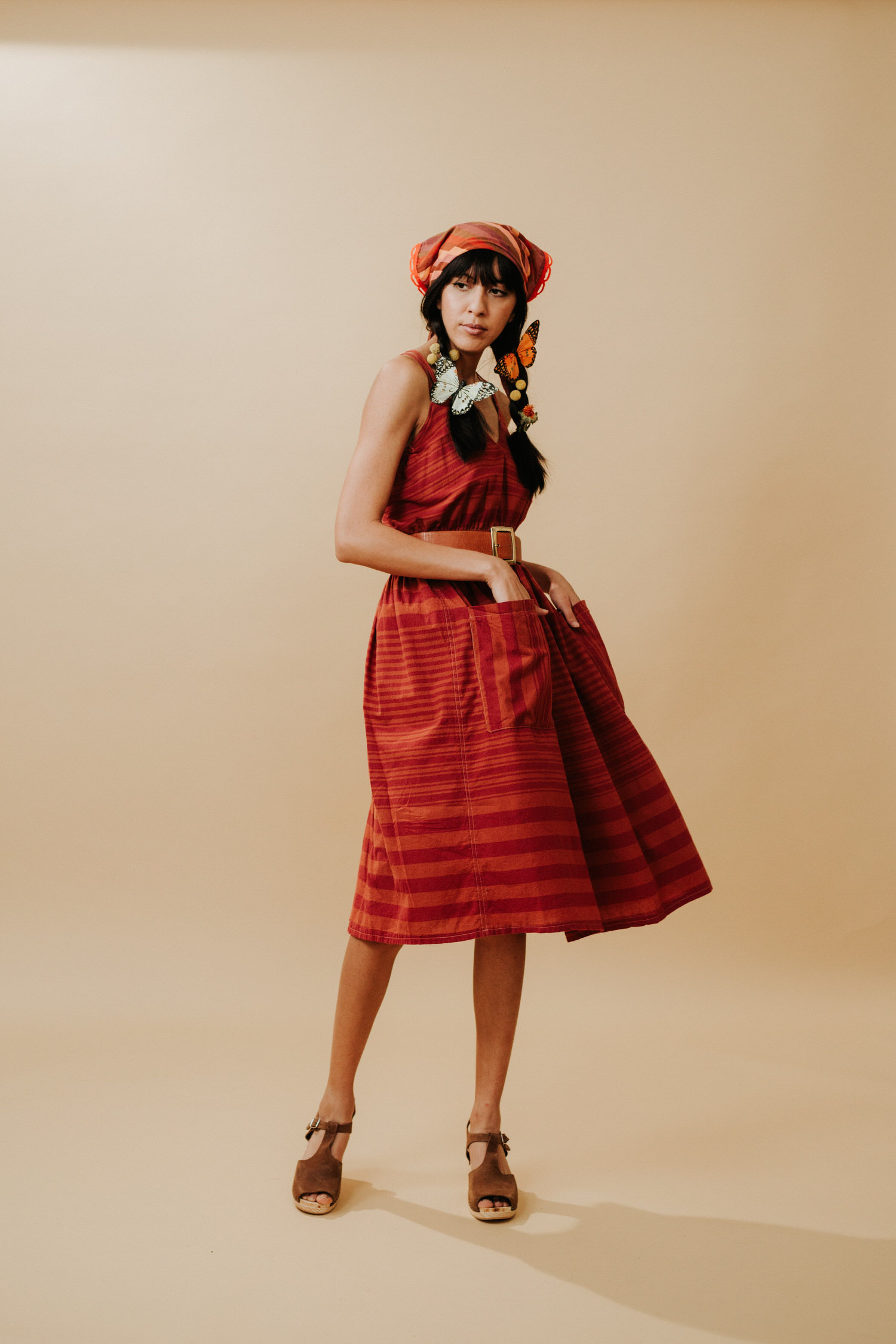 Woman in red vintage bandana and dress