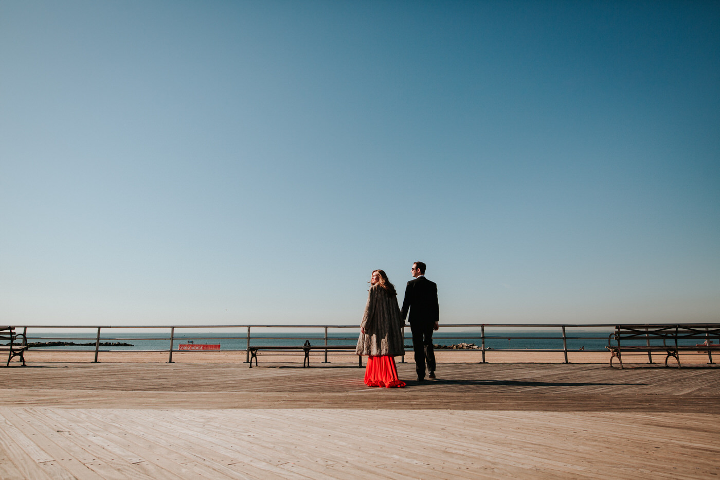 Engaged couple at Coney Island boardwalk