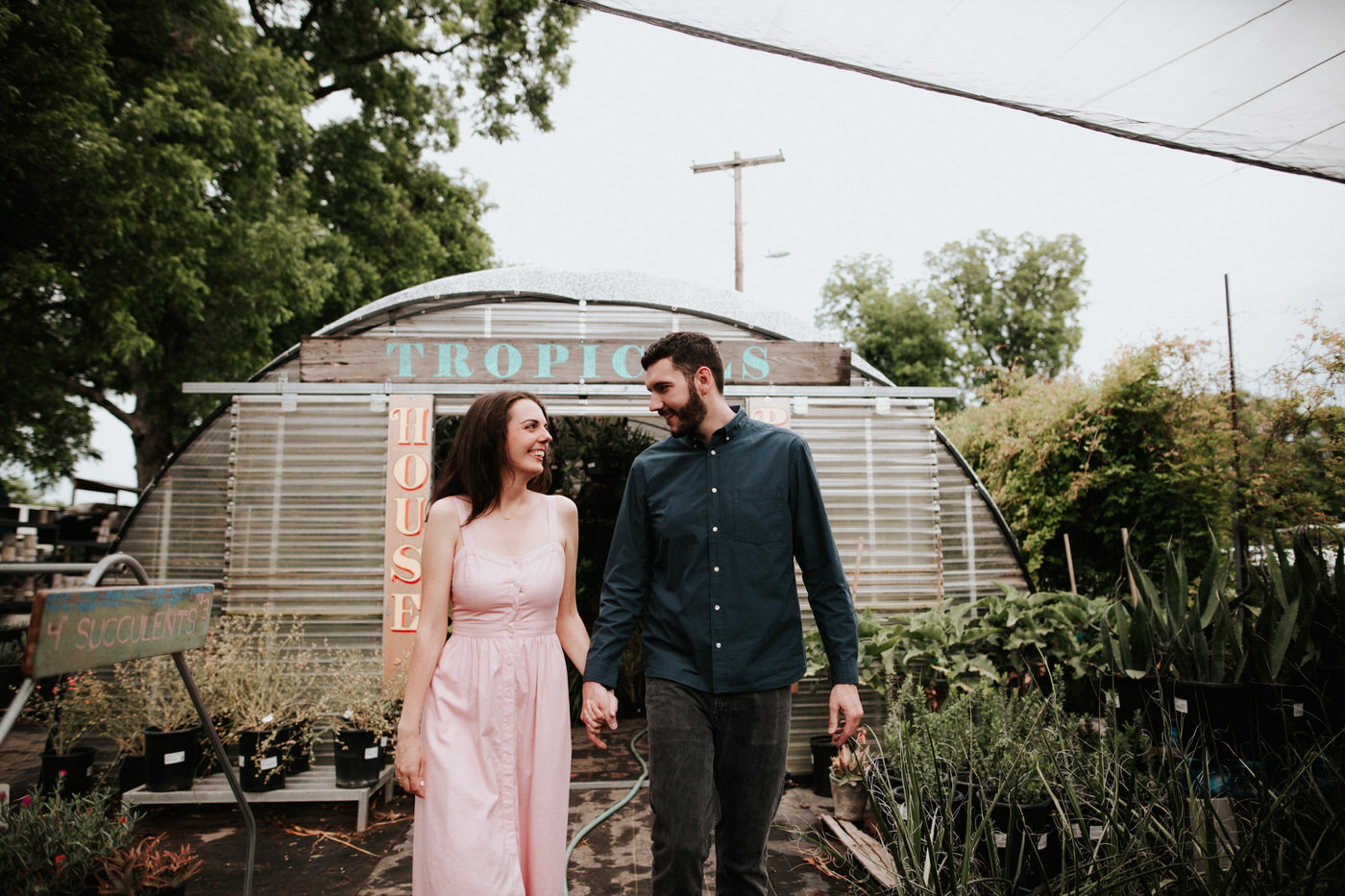 Engaged couple in East Austin surrounded by plants