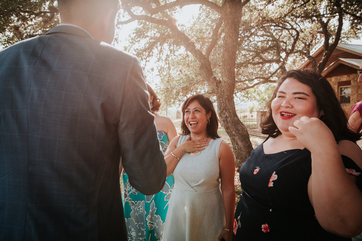 Wedding guests hugging at River House at Pedernales