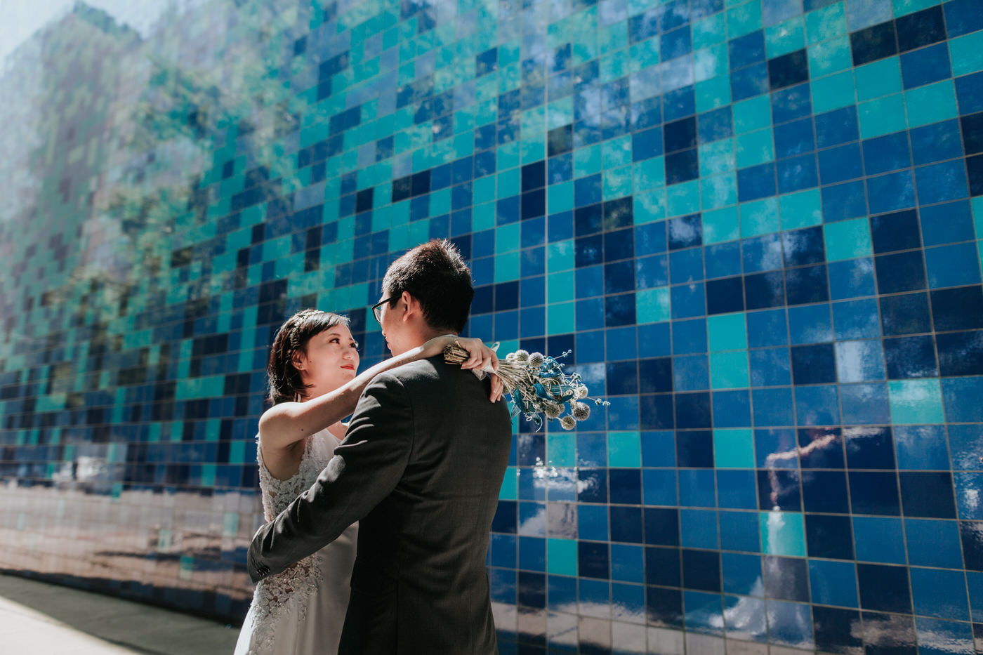 Couple at the Blue Tile Wall downtown Austin