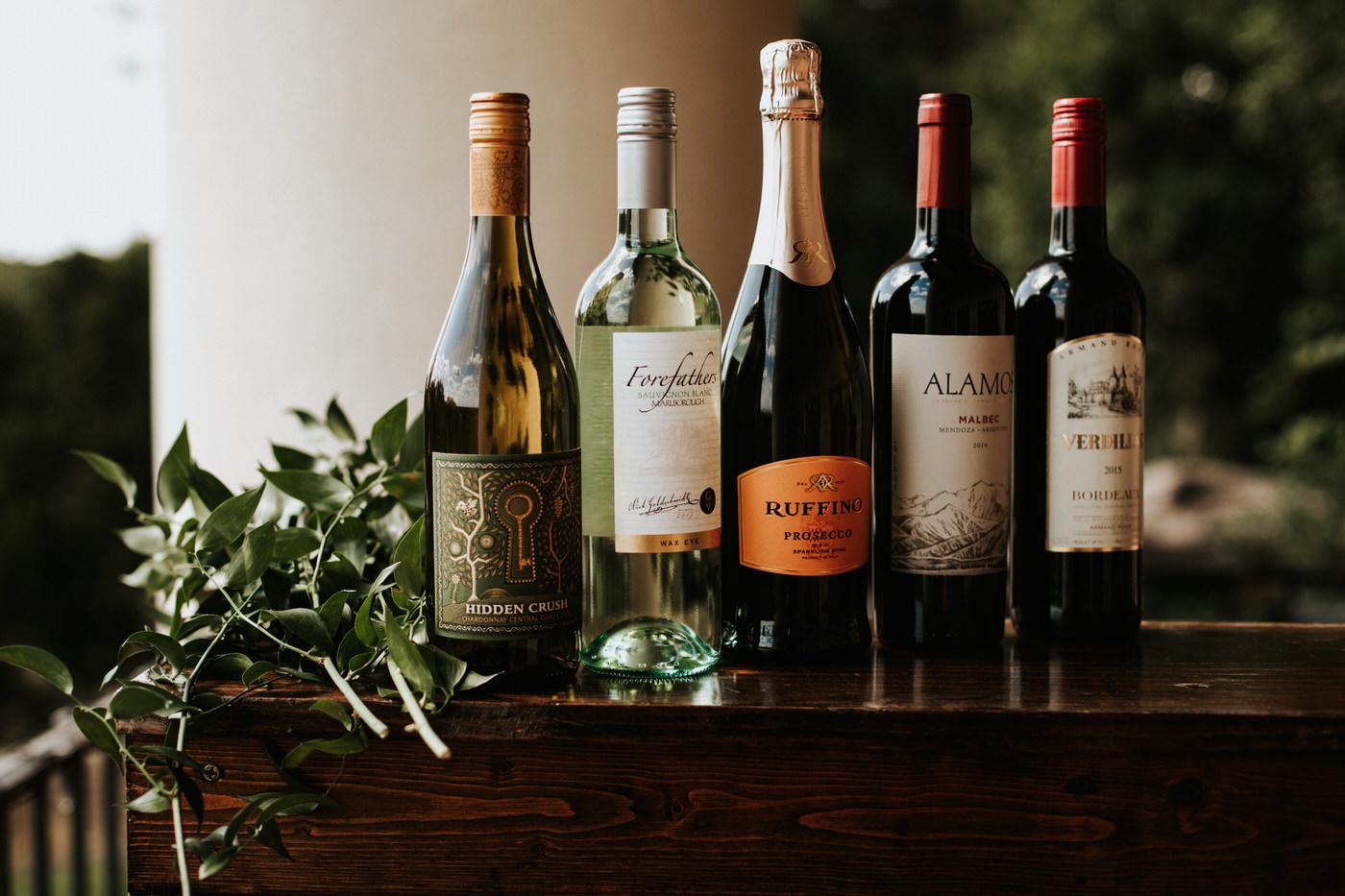 Wine bottles at wedding reception