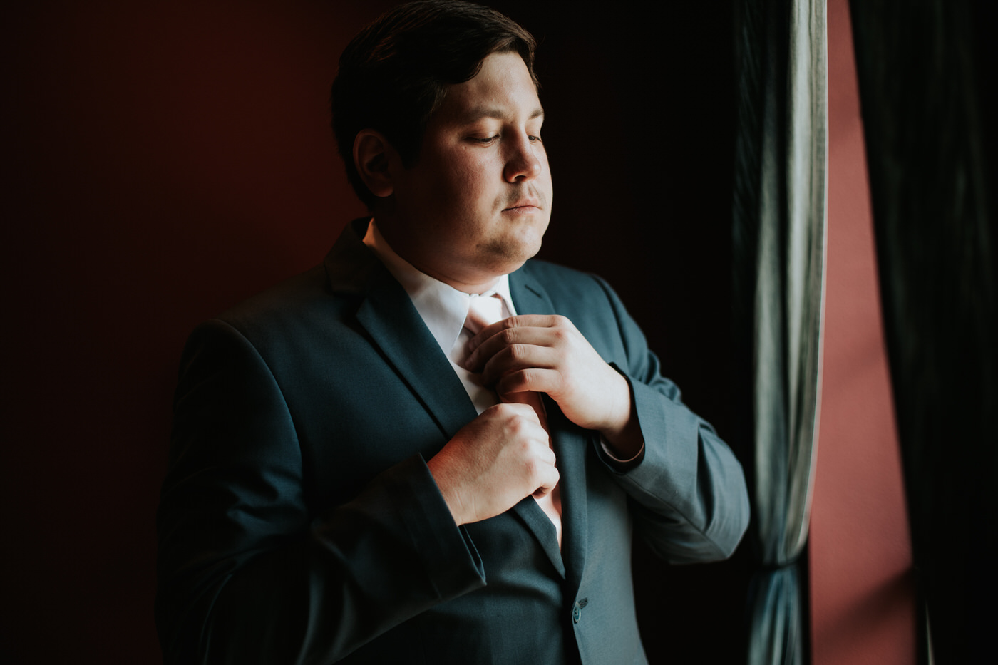 Groom getting ready at Thurman's mansion