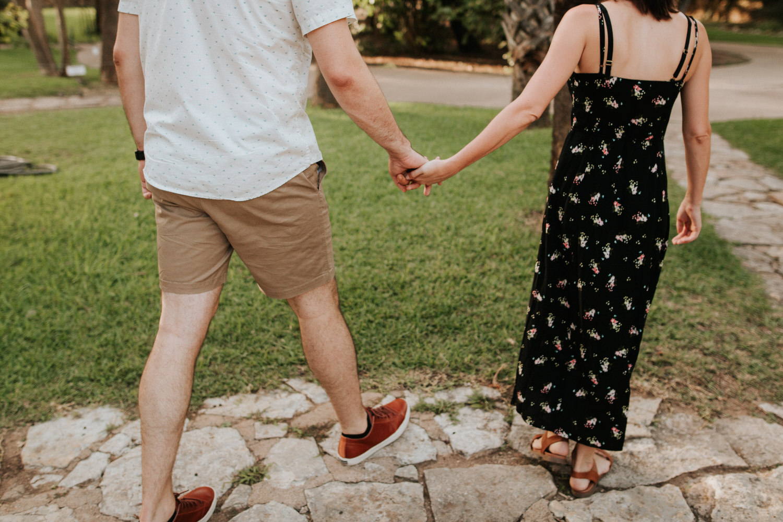 Happy engaged couple at Mayfield Park in Austin near Laguna Gloria