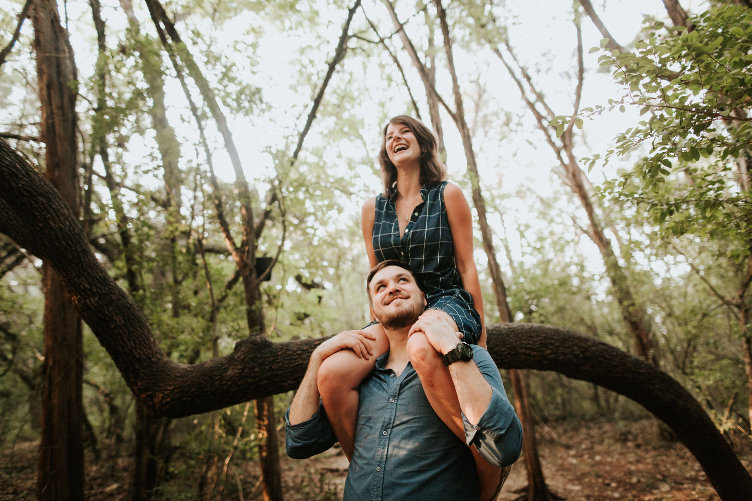 Laughing woman on man's shoulders