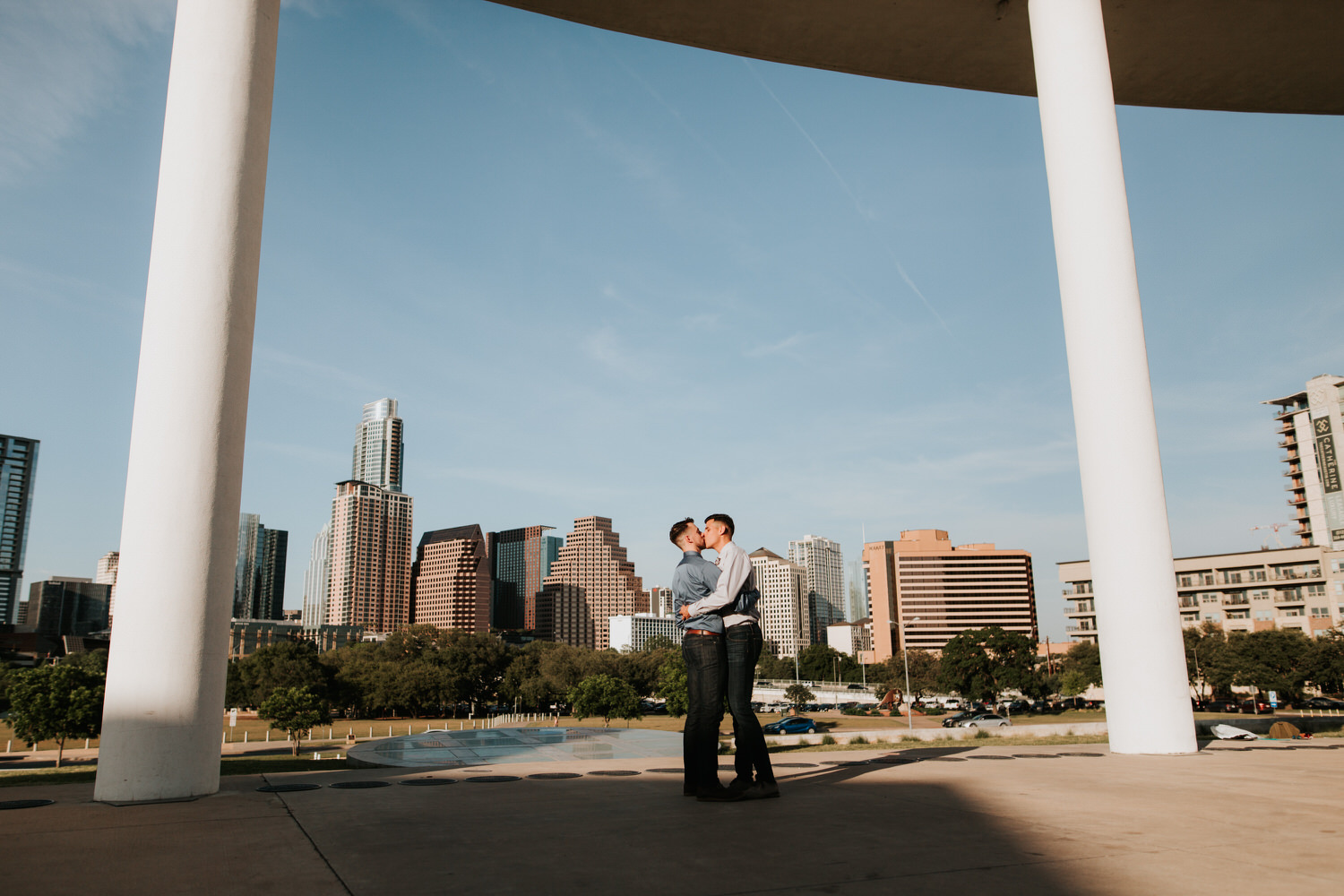 Happy engaged gay couple at The Long Center in Austin
