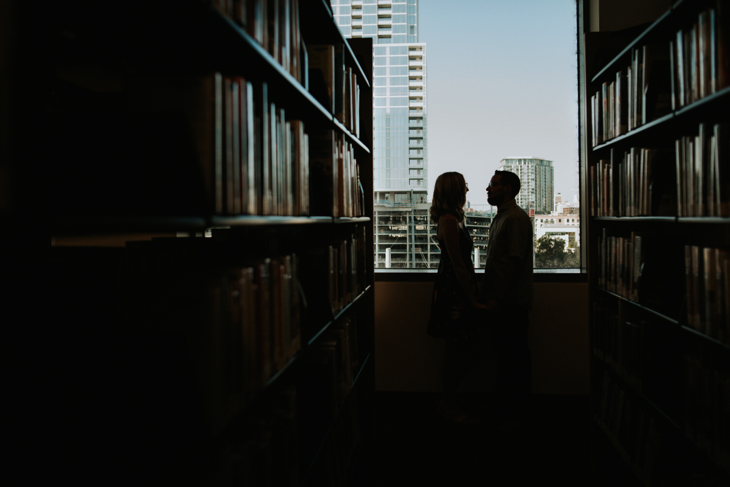 Couple kissing in the library