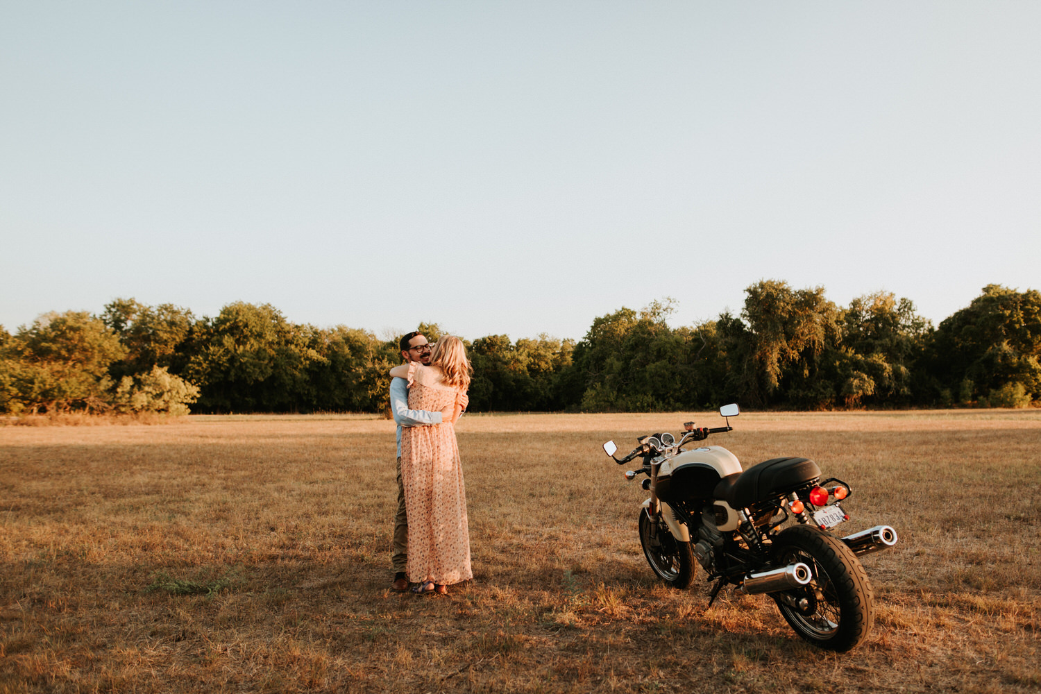 Engaged couple at McKinney Falls State Park on a motorcycle