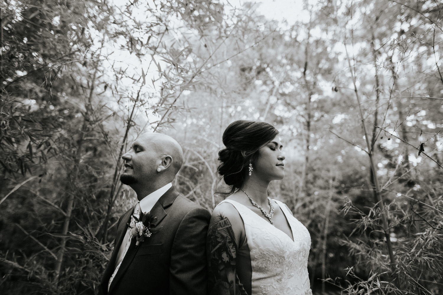 Happy couple at wedding in black and white